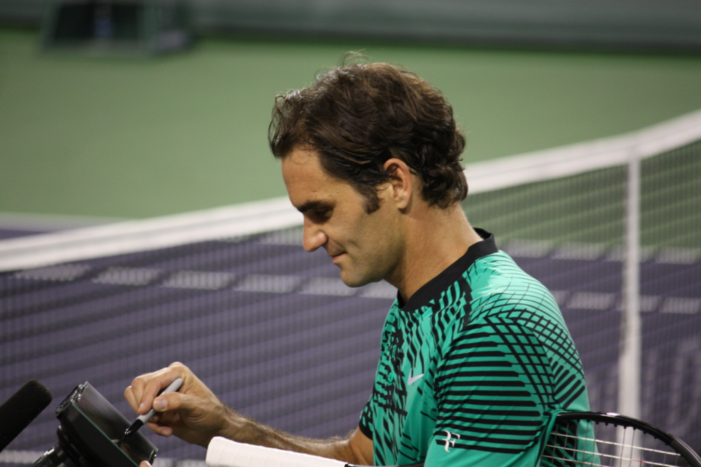 Roger Federer signs an autograph at the BNP Paribas Open in Indian Wells, California